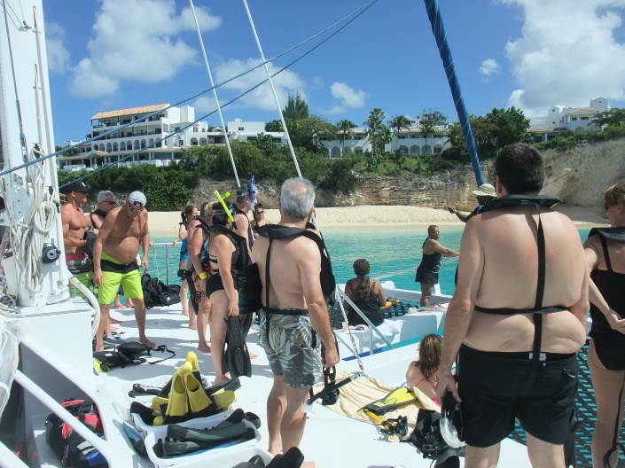 The others getting their snorkeling gear on, ready to get in