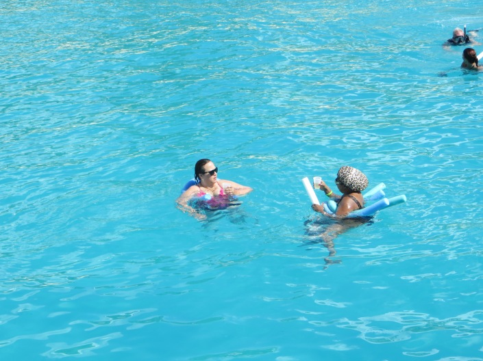 Me and Sheryl having a Champagne meeting while floating in the Sea